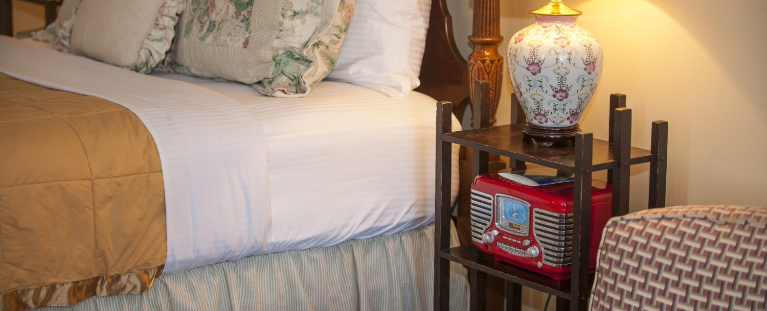 bedside table with radio and lamp