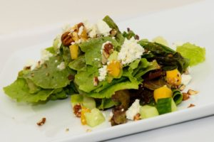 Newmans Restaurant Mixed Greens salad with goat cheese cucumbers pecans