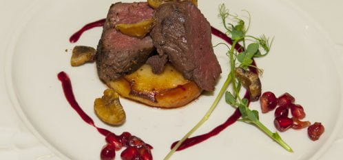 Venizon Tenderloin on Grilled Apple with Pomegranates, Chestnuts, and Micro Greens