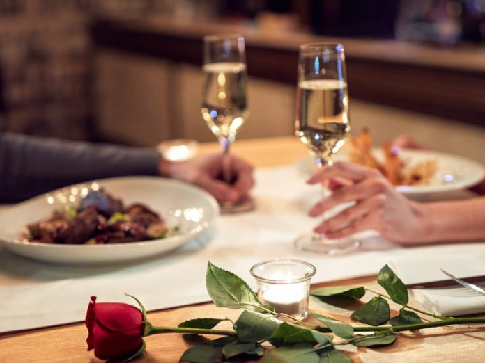 couple enjoying dinner; Romantic things to do in Asheville