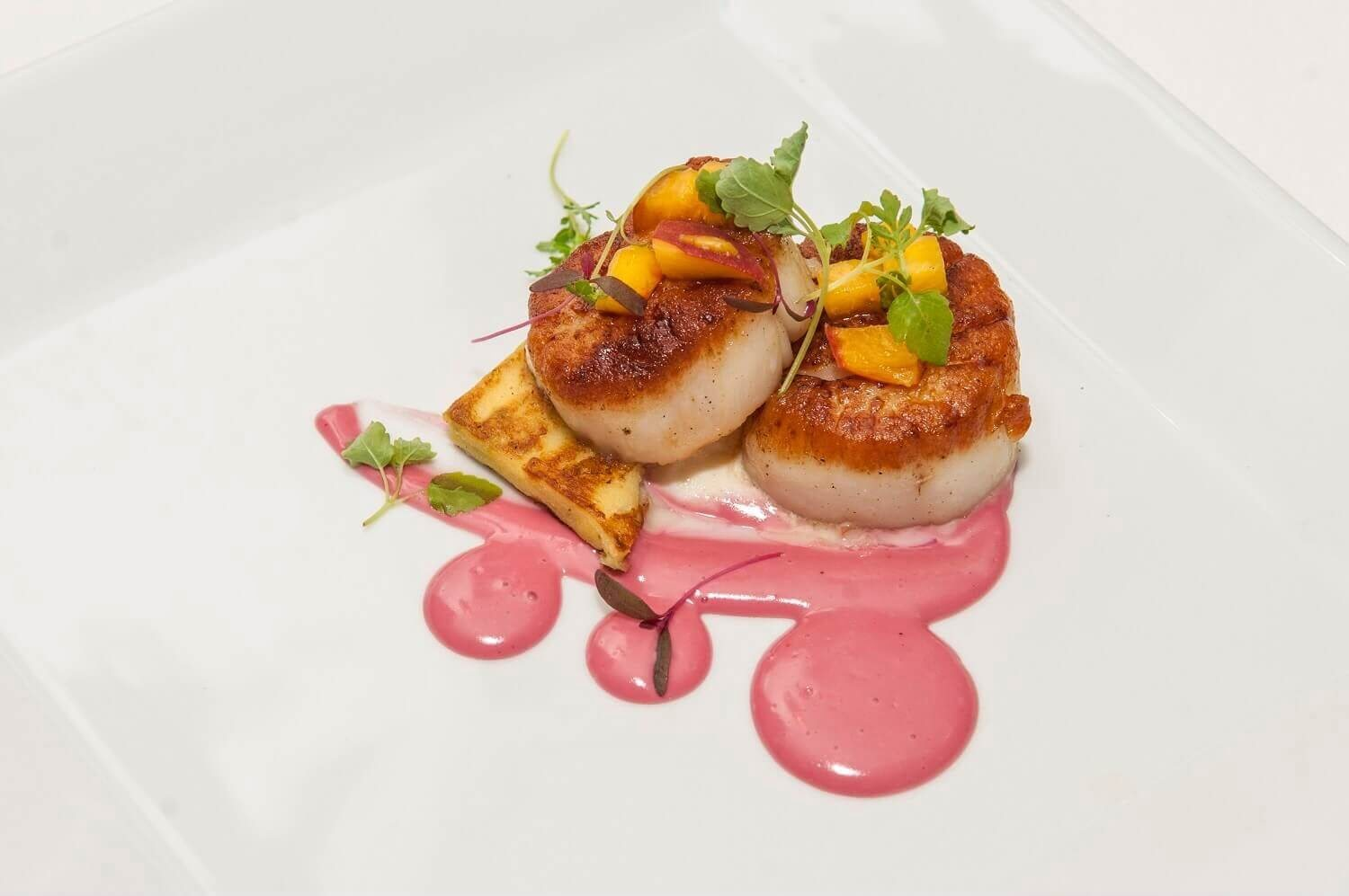Pan Seared Diver Scallop, Garlic Scape Panisse, Lemon Ricotta, Pickled Peaches, Micro Citrus Greens, Beet Aioli