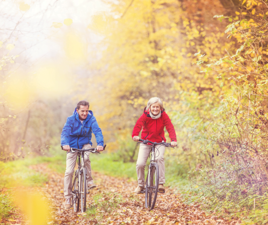 Couple in the forest enjoying a fall bike ride in NC